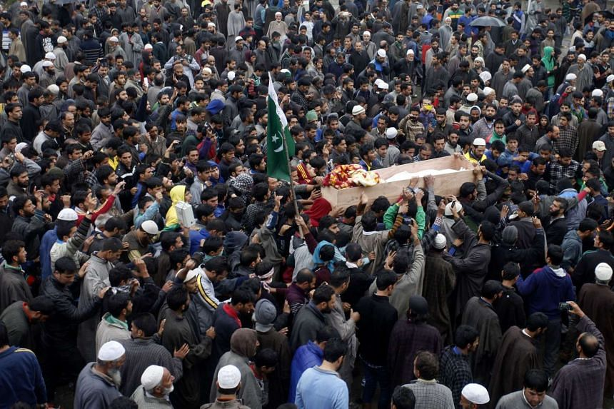 Kashmiri villagers shout pro-freedom slogans as they carry the body of truck conductor killed in a petrol bomb attack in Anantnag. Authorities imposed a curfew in Indian-administered Kashmir on Monday after protests over the death of a driver attacke