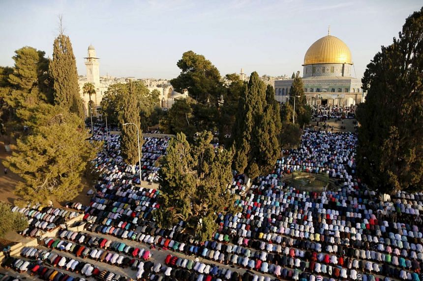 Muslim worshippers pray in front of the Dome of the Rock on the compound known to Muslims as Noble Sanctuary and to Jews as Temple Mount, in Jerusalem's Old City during Eid al-Adha last month.