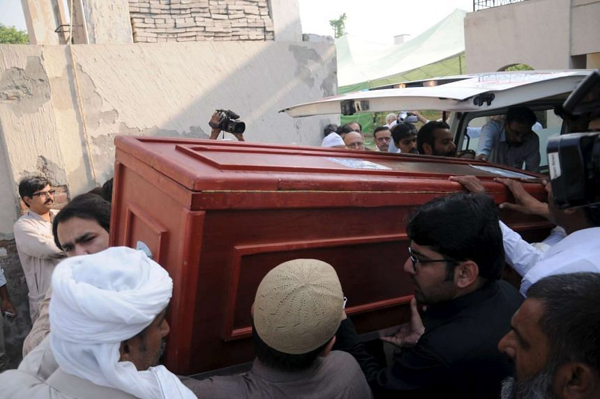 Men carry the casket of Asad Murtaza Gillani, former Pakistan's Prime Minister Yousaf Raza Gillani's nephew who was killed in the crush outside the Muslim holy city of Mecca last month, after his body arrived in Multan, Pakistan on Oct 5.