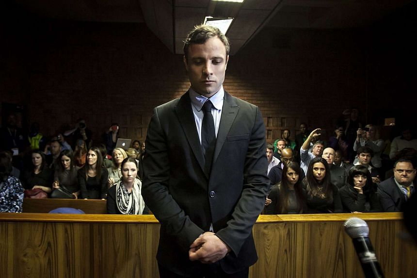 South African Paralympic athlete Oscar Pistorius as he appeared in the Pretoria Magistrates court in Pretoria on Aug 19, 2013.