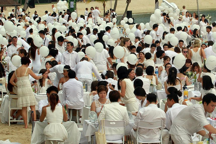 About 3,000 diners attended the Diner En Blanc picnic last year at Tanjong Beach in Sentosa.