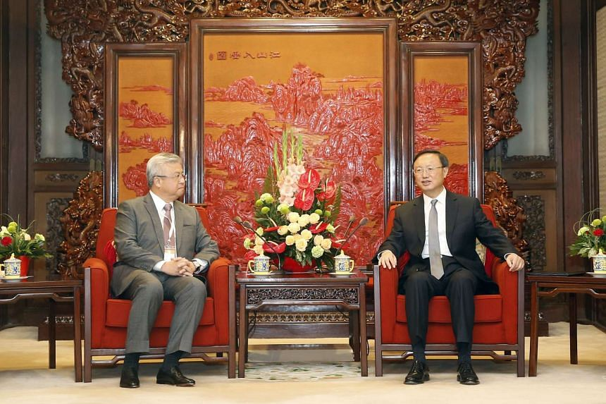 Mr Thomas Chua (left), president of the Singapore Chinese Chamber of Commerce and Industry, meeting China's State Councillor Yang Jiechi in Beijing yesterday.
