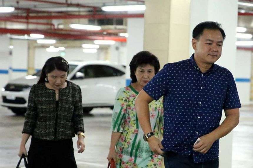 Mr Tan Chee Wee (right), the younger son of car workshop owner Tan Boon Sin, arriving for the trial of the murder of his father and elder brother.