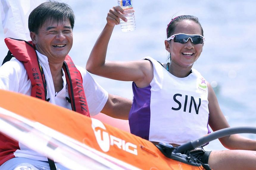 National Coach Chua tan ching (left) and Audrey Yong celebrate at the 2010 Youth Olympic Games.