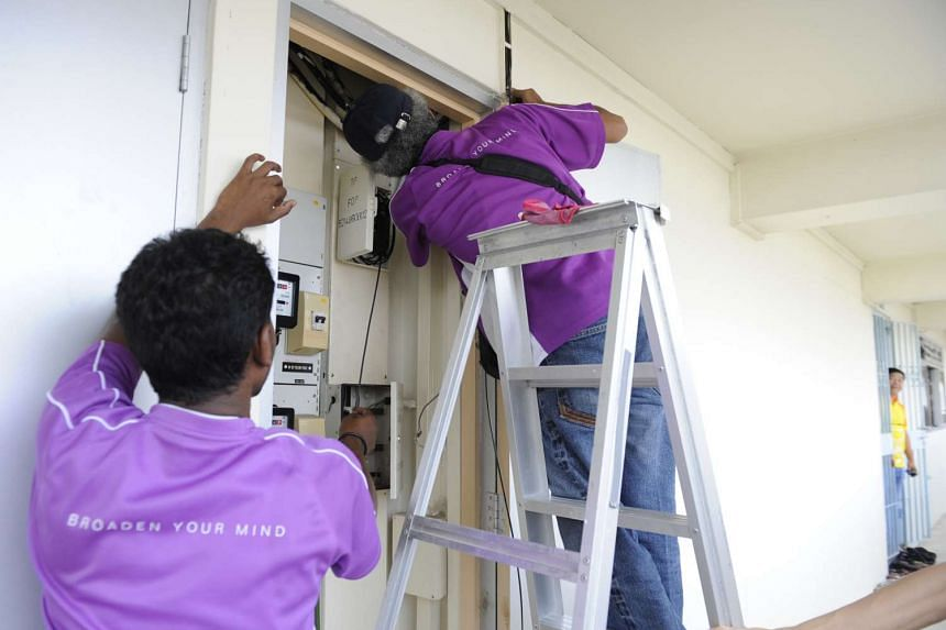 Contractors installing hardware for NetLink Trust, formerly OpenNet.