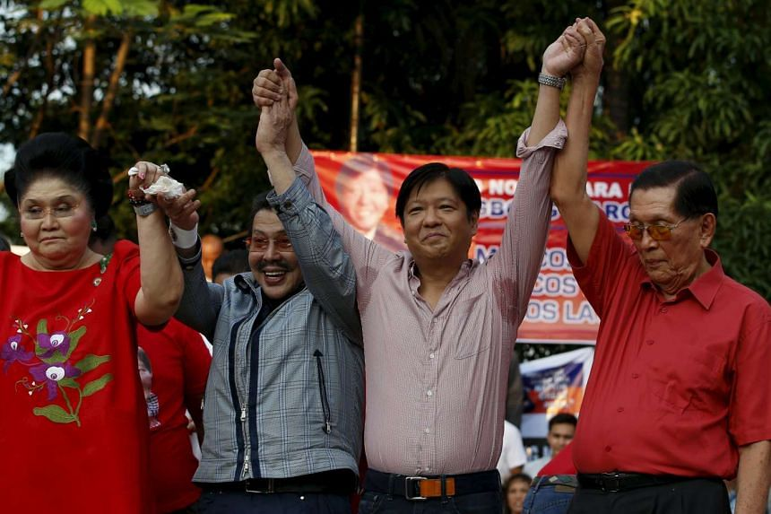 Philippine Senator Ferdinand Marcos Jr. (second right), is endorsed as a vice-presidential candidate by (from left) his mother, former first lady Imelda Marcos, former president Joseph Estrada and Senator Juan Ponce Enrile, during a political rally i