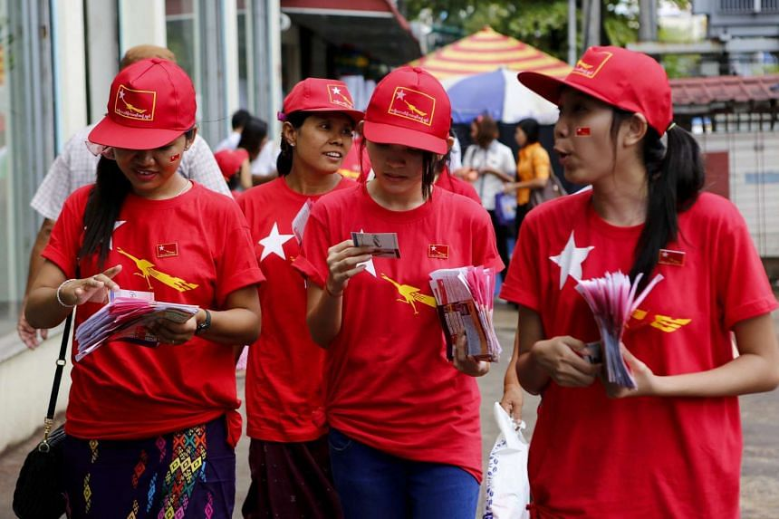 Members of National League for Democracy (NLD) party participate during the election campaign at downtown area in Yangon, Myanmar.