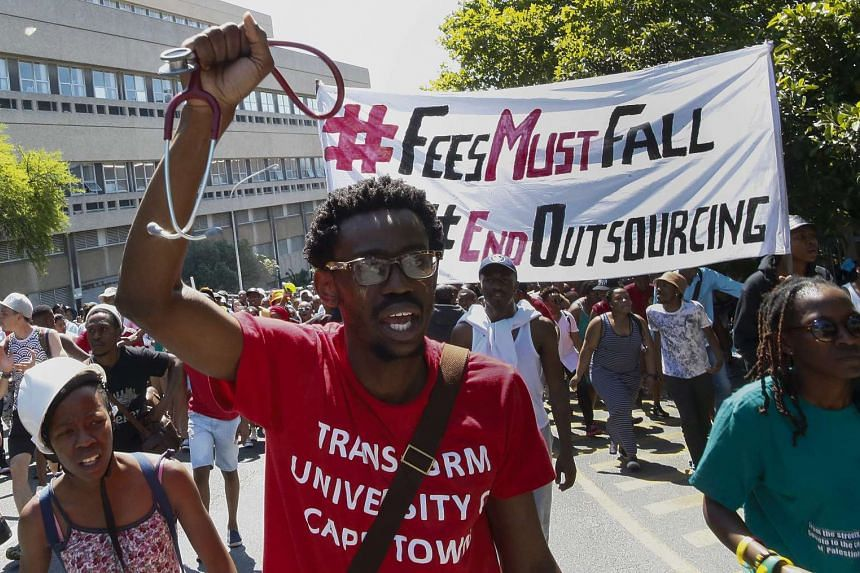 Students from the University of Cape Town (UCT) protest against a proposed hike in tuition fees, outside the medical school in Cape Town, South Africa, on Oct 20, 2015.