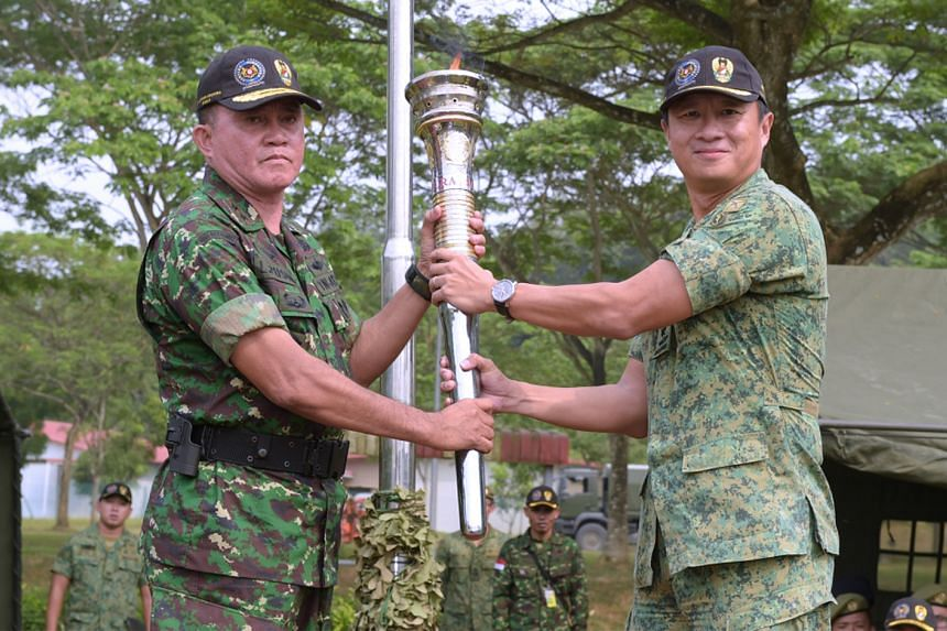 Commander 3rd Singapore Division (3 DIV) Brigadier-General Ong Tze-Ch'in (right) and Commander of Military Area I, Indonesian Army (TNI AD), Major General Lodewyk Pusung (left) at the closing ceremony of Exercise Safkar Indopura this morning.