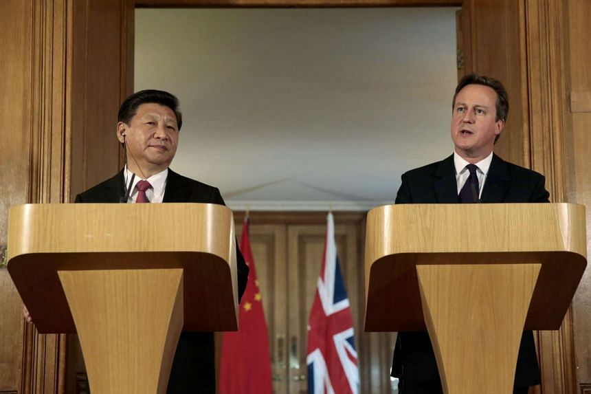 Chinese President Xi Jinping and British Prime Minister David Cameron speaking at a joint press conference at 10 Downing Street, in central London, on Oct 21, 2015.