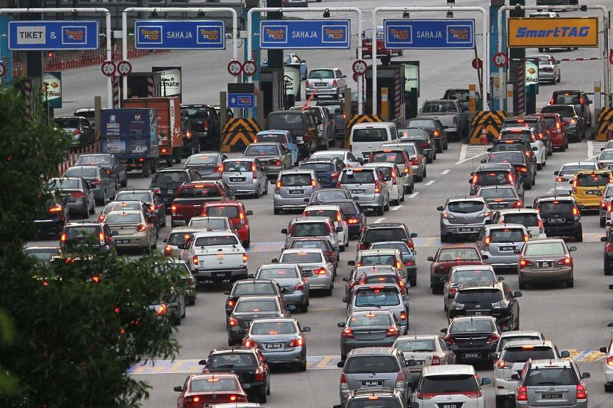 Motorists queueing at the Jalan Duta Plaza Toll on the Plus Highway in Kuala Lumpur.