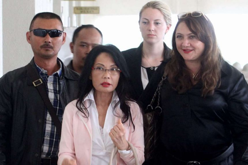 Malaysian tycoon Khoo Kay Peng and his estranged wife Pauline Chai (above, centre) racked up £5 million (S$10.8 million) in lawyers' bills over their divorce settlement dispute in Britain.