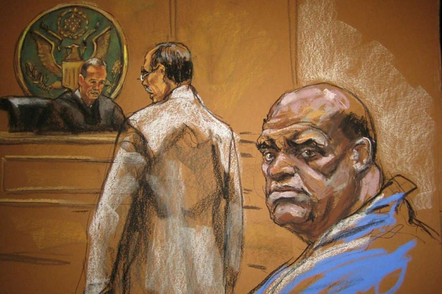 John Ashe (right), a former UN ambassador from Antigua and Barbuda who was general assembly president from 2013 to 2014, is shown in this courtroom sketch at his arraignment in New York on Oct 6, 2015.