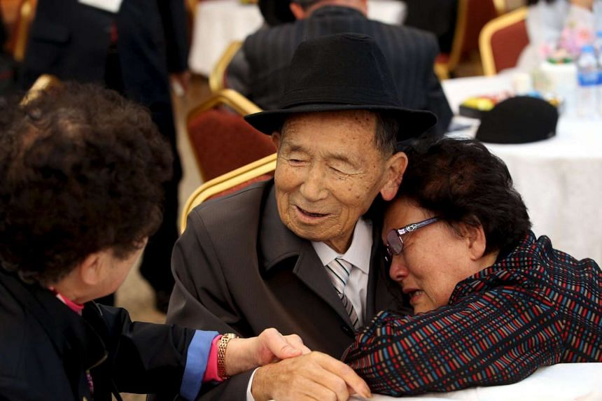 South Korean Kim Cheol Shik (right) reacts as she meets her North Korean relative Kim Han Shik during the separated family reunions at Mount Kumgang resort, North Korea, on Oct 20, 2015. Nearly 400 South Koreans crossed the heavily armed border into