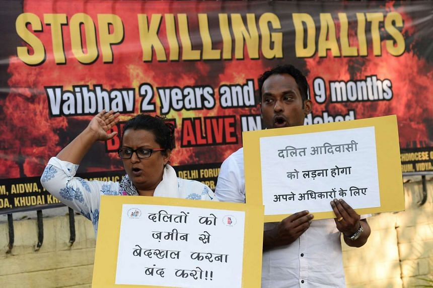 Indian social activists protesting after the killing of children in an arson attack, in New Delhi on Oct 21, 2015.