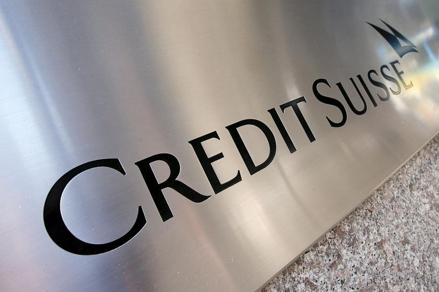A Credit Suisse sign is seen on the exterior of their Americas headquarters in the Manhattan, New York.