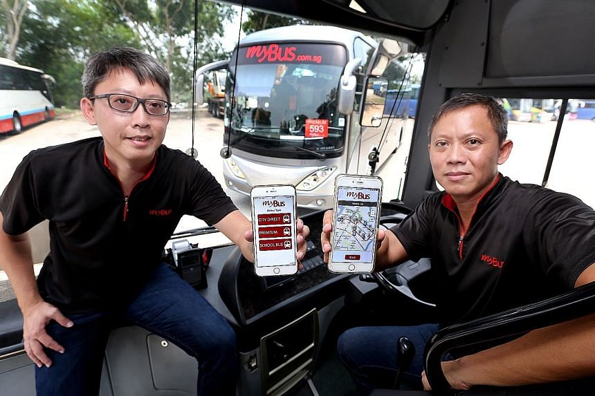 The co-directors of Loh Gim Chong Transport - brothers Loh Kian Meng (left), 40, and Louis Loh, 44 - showing the company's mobile app. The company paid $60,000 to get the live-tracking app developed for their customers' convenience.