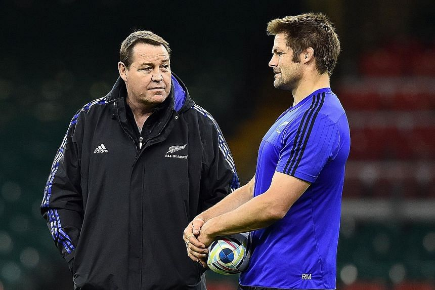 New Zealand head coach Steve Hansen (left) discussing tactics with captain Richie McCaw at training in Cardiff last week.