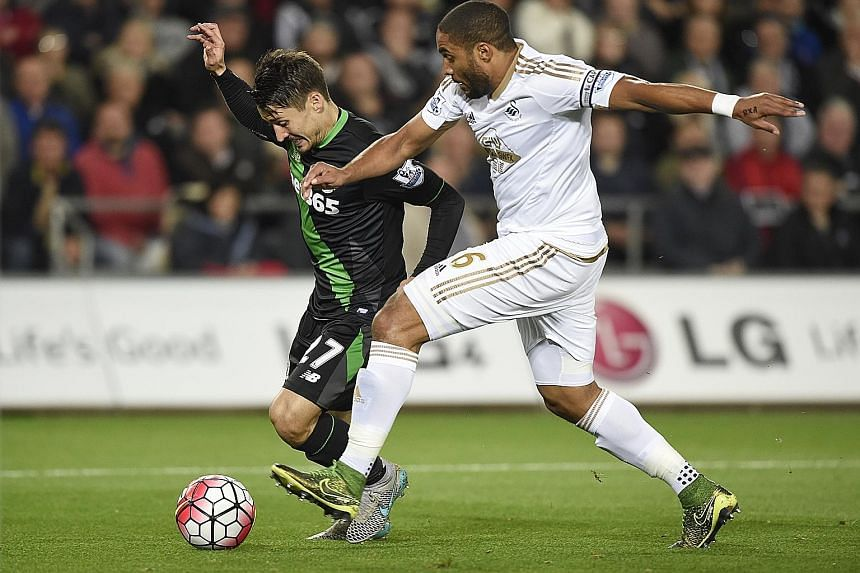Stoke's Bojan Krkic is brought down in the box by Swansea's Ashley Williams, before he got up to net the resulting penalty for a 1-0 win.