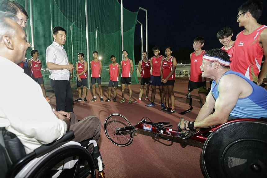(From left) Asean Para Games chef de mission Raja Singh (in wheelchair), Singapore Disability Sports Council president Dr Teo-Koh Sock Miang (partially hidden), Minister for Social and Family Development Tan Chuan-Jin and wheelchair athlete Jack Lai