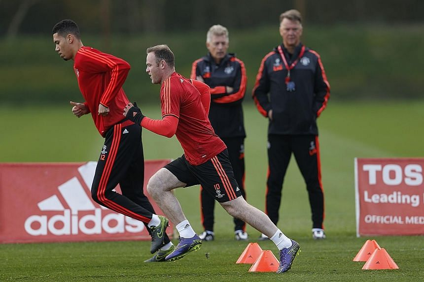 Manchester United captain Wayne Rooney (front) and Chris Smalling are put through their paces, as manager Louis van Gaal and training physiologist Jos van Dijk look on during training yesterday. Moscow is a happy hunting ground, as United won their t