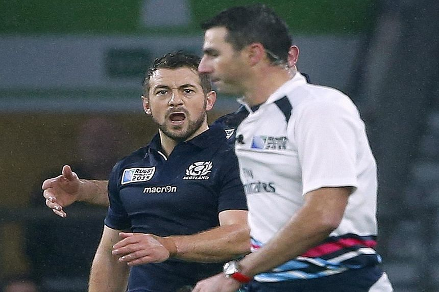 An aggrieved Scotland captain and scrum-half Greig Laidlaw shouting at referee Craig Joubert after he awarded a penalty to Australia in the last minute of their quarter-final. Bernard Foley's kick gave the Wallabies a 35-34 win.
