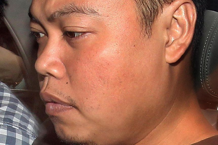 Murder suspect Iskandar Rahmat was caught after a 54-hour manhunt.