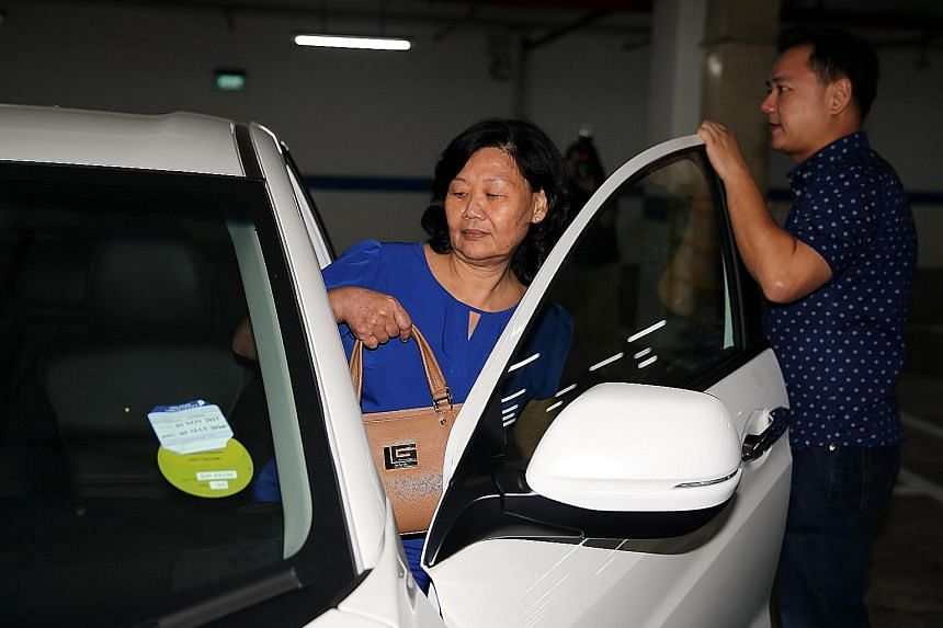 Madam Ong Ah Tang, 66, widow of the elder Kovan murder victim Tan Boon Sin and mother of the younger victim Tan Chee Heong, preparing to leave the Supreme Court yesterday with her son Tan Chee Wee after testifying during the first day of the murder t