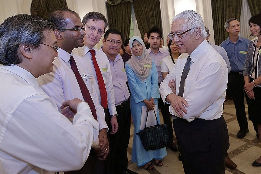 President Tony Tan Keng Yam speaking to senior lecturers from Nanyang Polytechnic - (from left) Mr Jeffrey Seng, Dr Saji George and Mr Christof Luda - during a reception at the Istana yesterday. The reception is part of the annual Public Service Mont