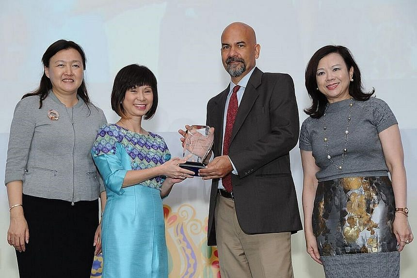 Mr Nirmal Ghosh receiving his merit award from Dr Amy Khor at the fourth Asian Environmental Journalism Awards yesterday. With them were Singapore Environment Council chairman Isabella Loh (far left) and City Developments chief sustainability officer