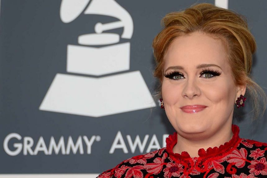 Singer Adele arrives on the red carpet for the 55th Grammy Awards in February 2015.