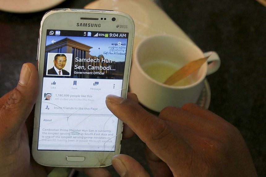 A person using a smartphone to look at the Facebook page of Cambodia's PM Hun Sen in Cambodia on Oct 7, 2015.