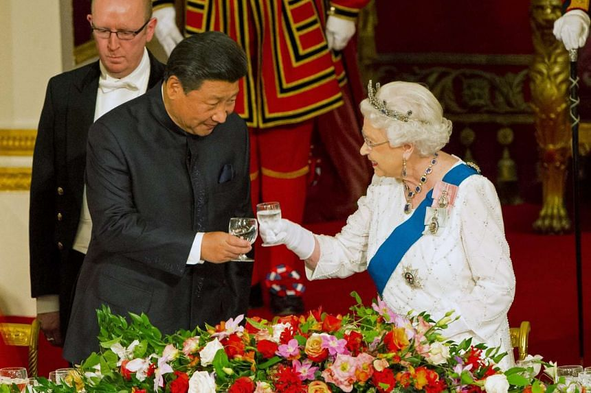 Chinese President Xi Jinping with Queen Elizabeth at a state banquet at Buckingham Palace, London, during the first day of his state visit to Britain.