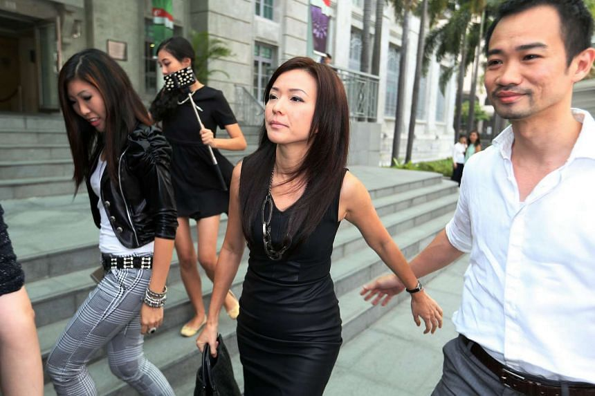Former CHC finance manager Serina Wee and her husband Kenny Low (right) arriving at the State Courts.