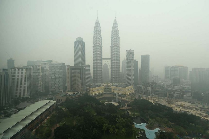 Malaysia's iconic Petronas twin towers and Kuala Lumpur's skyline are shrouded in thick haze on Oct 21, 2015.