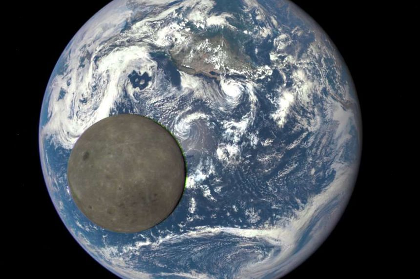 An image of the far side of the moon as it crosses between a Nasa probe and the Earth, a million miles away.