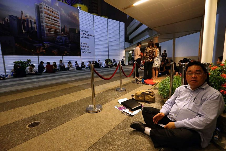 Mr Benjamin Lam (right) was the first person in the queue at 10pm on Oct 20.