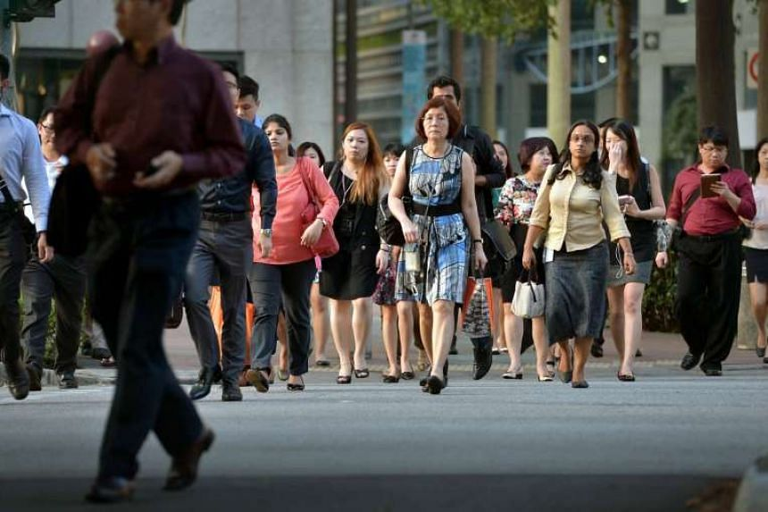 Office workers in the central business district. More than 500 cash grants are up for grabs for Singaporean workers who want to deepen their skills.