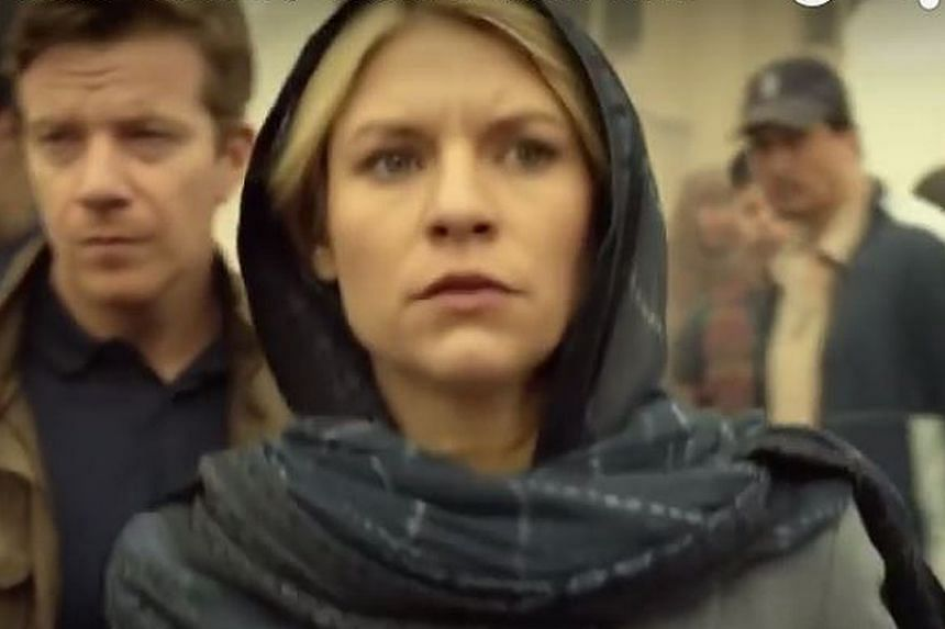 Claire Danes is a happy civilian, but not for long, in Homeland.