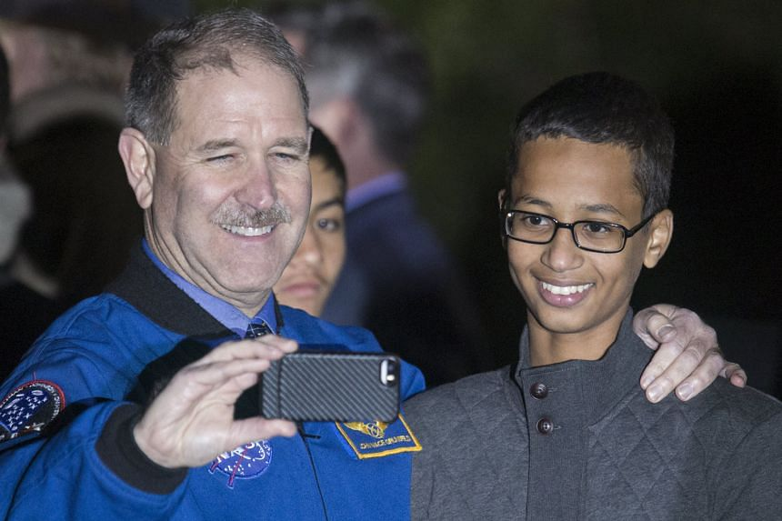 Dr John Grunsfeld of Nasa's science mission directorate posing for a selfie with Ahmed Mohamed, the Texas teen who was arrested over a homemade clock, during White House Astronomy Night on Monday.