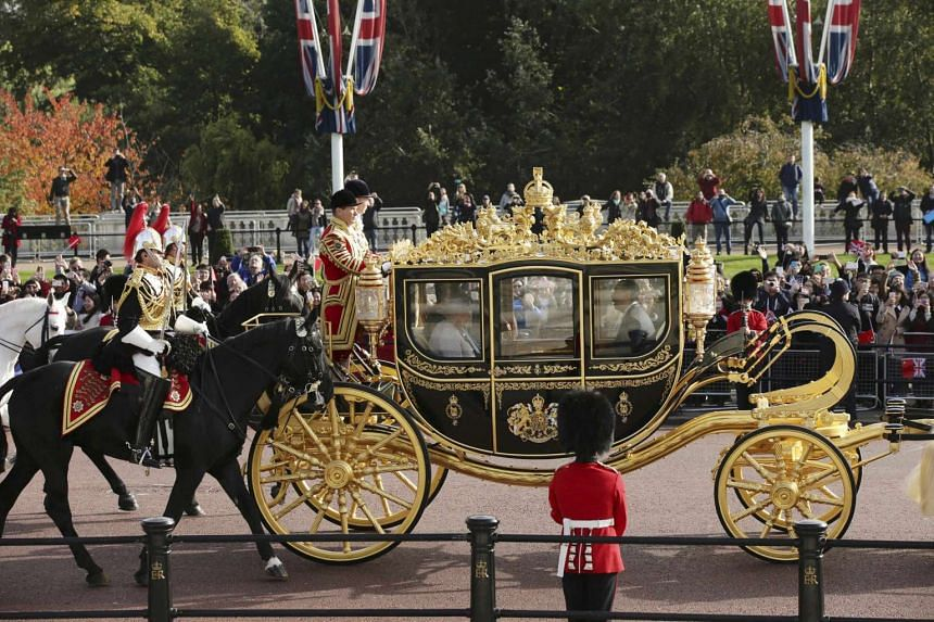 Britain's Queen Elizabeth and the President of China, Xi Jinping, are driven by carriage along The Mall to Buckingham Palace.