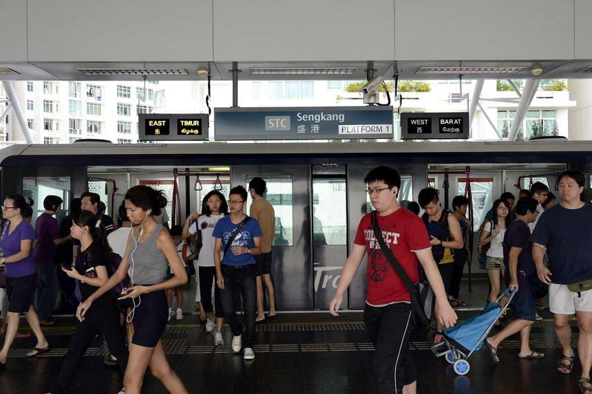 Commuters disembarking at the Sengkang LRT station.