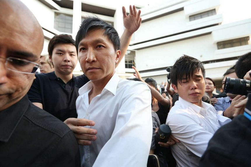 City Harvest Church founder Kong Hee (centre in white) leaving the Subordinate Courts on Jun 27, 2012.