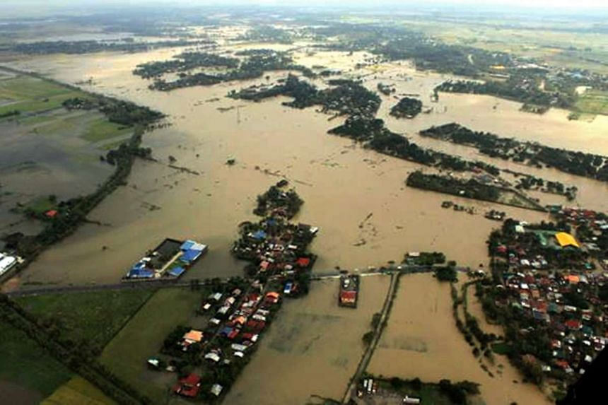A handout picture provided by Philippine Airforce Public Information Office shows flooded rice field in the Municipality of Camiling, Philippines, on Oct 20, 2015.