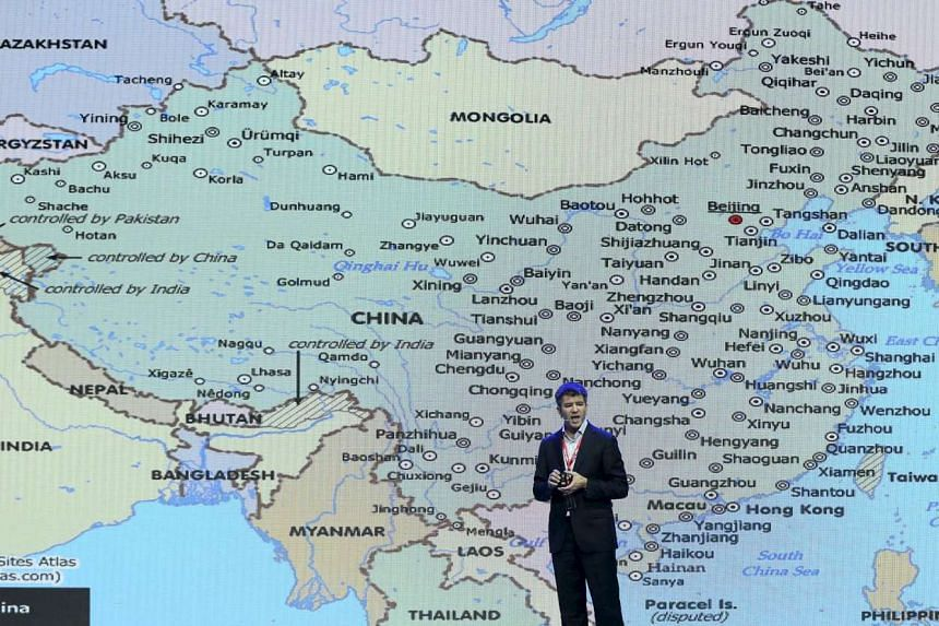 Uber CEO Travis Kalanick speaking in front of an electronic board showing a map of China at the 2015 Baidu World Conference in Beijing, China, on Sept 8, 2015.