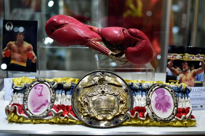 The Champioship Belt and gloves from the Sylvester Stallone films Rocky II & Rocky III on display during a press preview of Heritage Auctions upcoming auction.