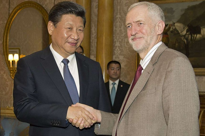 Jeremy Corbyn (right) with China's President Xi Jinping at Buckingham Place in London.