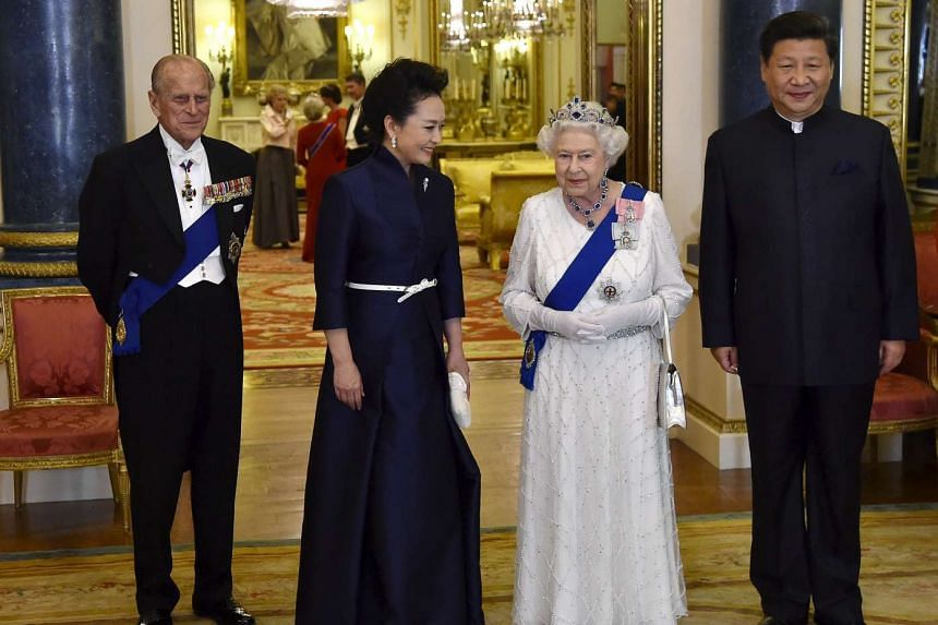 (From far left) Britain's Prince Philip, China's First Lady Peng Liyuan, Queen Elizabeth II and Chinese President Xi Jinping arriving for a state banquet at Buckingham Palace in London on Tuesday.