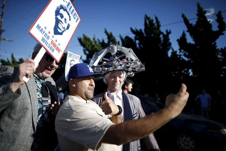 Dressed as characters from the film Back to the Future Part II, Toby Fulp, 38, (right) and Tommy Mack, 45, stand outside the Burger King featured in the movie, in Los Angeles on Oct 21, 2015.