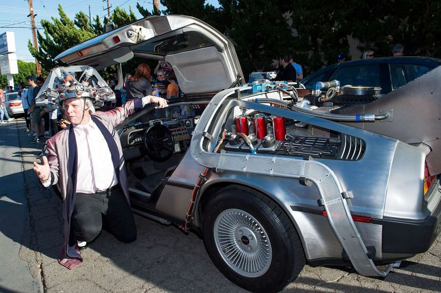 A fan poses for a photo at the Million McFly March to celebrate the movie Back to the Future in Burbank, California, on Oct 21, 2015.